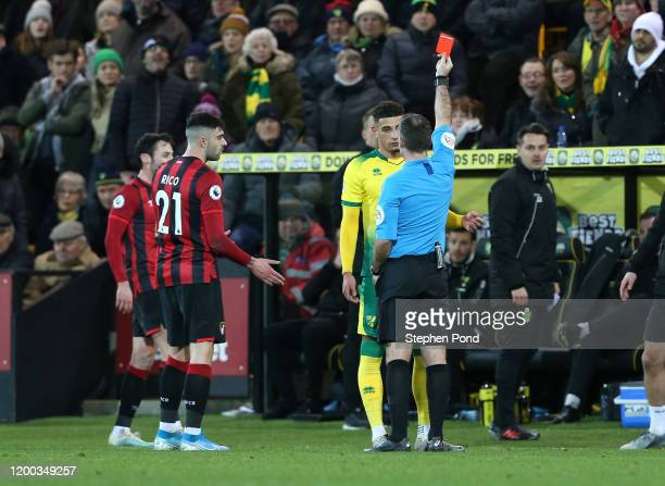 Referee Paul Tierney shows a red card to Ben Godfrey of Norwich City during the Premier League match between Norwich City and AFC Bournemouth at...