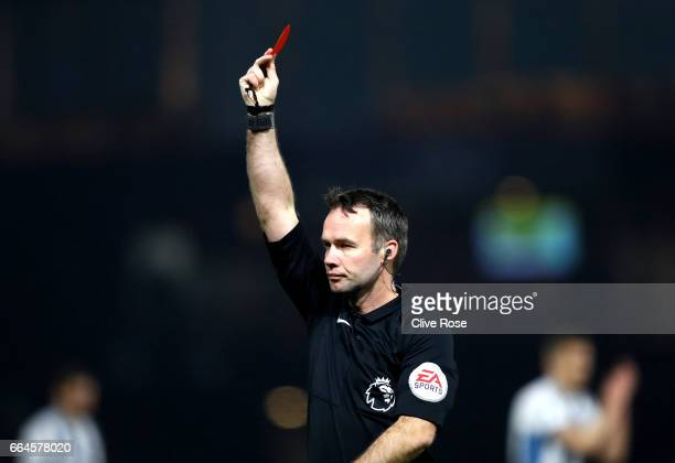 Referee Paul Tierney shows a red card to Miguel Britos of Watford during the Premier League match between Watford and West Bromwich Albion at...