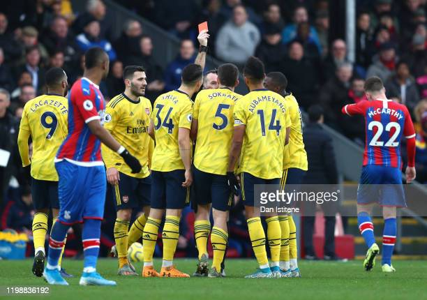 Referee Paul Tierney shows a red card to PierreEmerick Aubameyang of Arsenal during the Premier League match between Crystal Palace and Arsenal FC at...