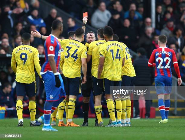Referee Paul Tierney shows a red card to Pierre-Emerick Aubameyang of Arsenal during the Premier League match between Crystal Palace and Arsenal FC...