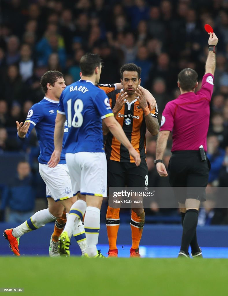 Referee Paul Tierney shows a red card to Tom Huddlestone of Hull City (8) as he is sent off during the Premier League match between Everton and Hull City at Goodison Park on March 18, 2017 in Liverpool, England.