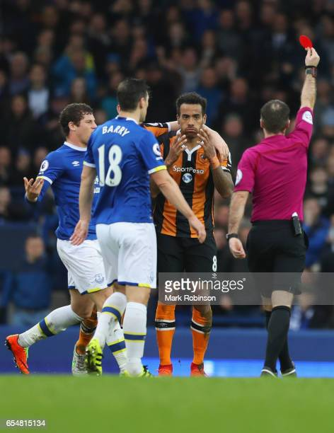 Referee Paul Tierney shows a red card to Tom Huddlestone of Hull City as he is sent off during the Premier League match between Everton and Hull City...