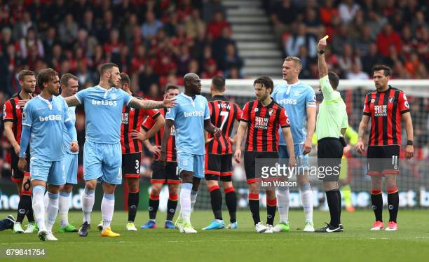 Referee Paul Tierney shows Harry Arter of AFC Bournemouth a yellow card during the Premier League match between AFC Bournemouth and Stoke City at the...
