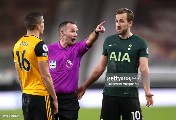 Referee, Paul Tierney talks with Harry Kane of Tottenham Hotspur and Conor Coady of Wolverhampton Wanderers during the Premier League match between...