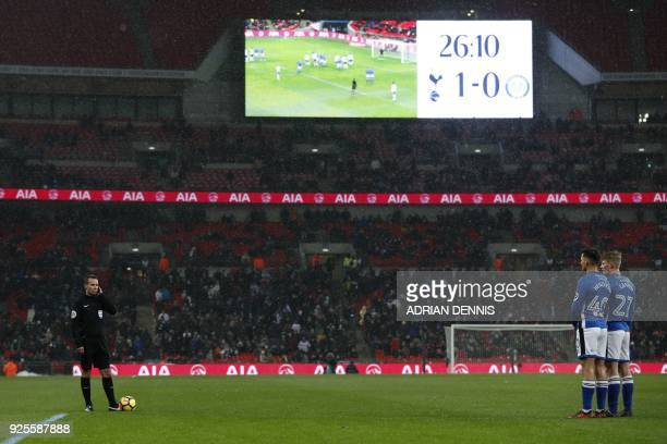 Referee Paul Tierney waits for a VAR decision during the English FA Cup 5th round replay football match between Tottenham Hotspur and Rochdale at...