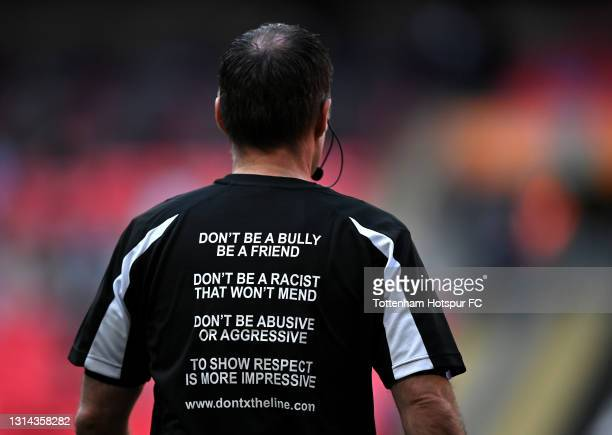 Referee, Paul Tierney wears a 'Don't Cross The Line' t shirt in support of the anti racism campaign prior to the Carabao Cup Final between Manchester...