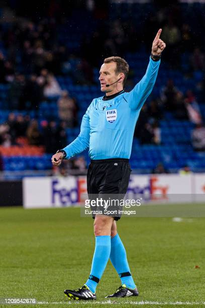 Referee Pavel Kralovec gestures during the UEFA Europa League round of 32 second leg match between FC Basel and APOEL Nikosia at St JakobPark on...