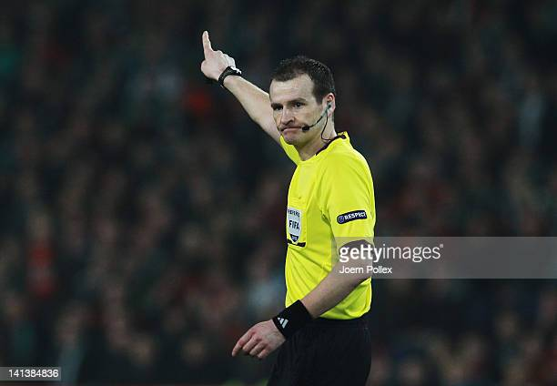 Referee Pavel Kralovec gestures during the UEFA Europa League second leg round of 16 match between Hannover 96 and Standard Liege at AWD Arena on...
