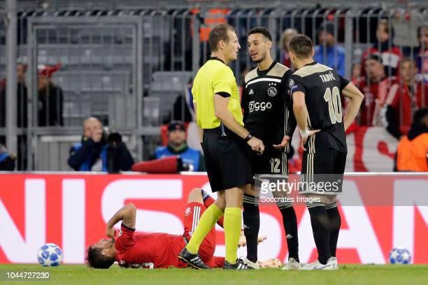 referee Pavel Kralovec Javi Martinez of Bayern Munchen Nicolas Tagliafico of Ajax during the UEFA Champions League match between Bayern Munchen v...