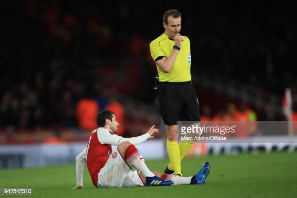 Referee Pavel Kralovec looks on as Henrikh Mkhitaryan of Arsenal reacts to injury during the UEFA Europa League quarter final leg one match between...