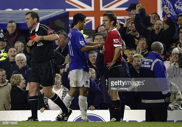 Referee, P.Dowd, puts the red card in his pocket after sending off Gary Neville during the Barclays Premiership match between Everton and Manchester...