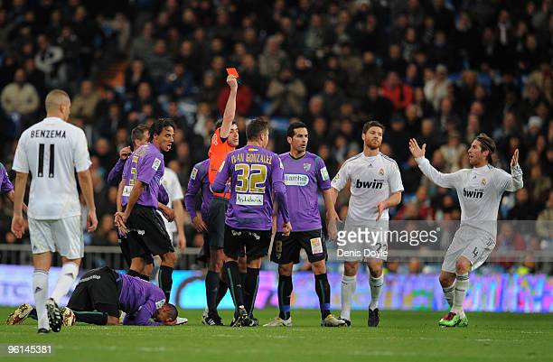 Referee Perez Laza shows the red card to Cristiano Ronaldo of Real Madrid during the La Liga match between Real Madrid and Malaga at the Santiago...