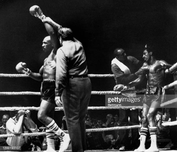 Referee Pete Bennett, raises the arm of Brockton, MA fighter Marvin Hagler, for the win after stopping fighting in the third round. Hagler, gained a...