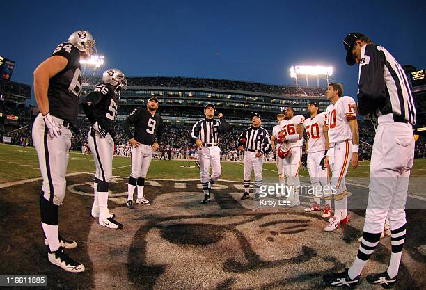 Referee Pete Morelli conducts coin toss as field judge Jim Saracino presides before NFL Network game between the Kansas City Chiefs and Oakland...