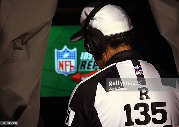 Referee Pete Morelli reviews a play in the instant replay booth during the preseason game between the Miami Dolphins of the Kansas City Chiefs on...