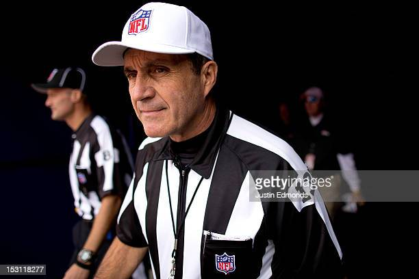 Referee Pete Morelli walk out of the tunnel towards the field before a game between the Oakland Raidersand Denver Broncos at Sports Authority Field...