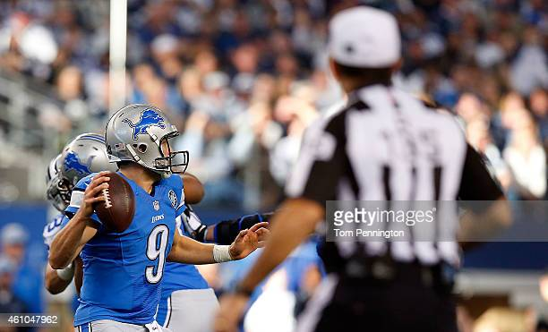 Referee Pete Morelli watches as Matthew Stafford of the Detroit Lions passes against the Dallas Cowboys during the first half of their NFC Wild Card...