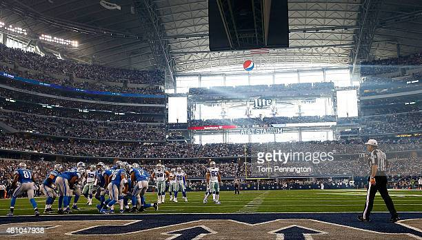 Referee Pete Morelli watches as the Detroit Lions break the huddle during the first half of their NFC Wild Card Playoff game against the Dallas...