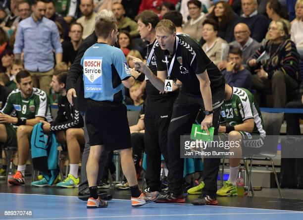 Referee Peter Behrens and Volker Zerbe of Fuechse Berlin argue during the game between Fuechse Berlin and dem MT Melsungen on december 10 2017 in...