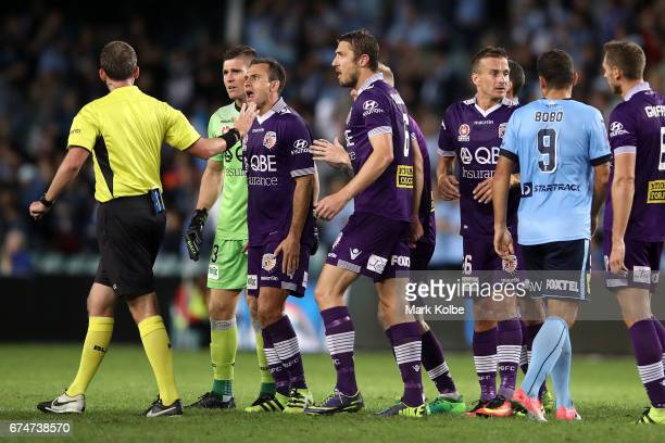 Referee Peter Green holds his hand up to Liam Reddy Richard Garcia and Dino Djulbic of the Glory as they make their point after a Sydney FC goal...
