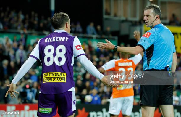 Referee Peter Green talks to Neil Kilkenny of the Perth Glory during the round 27 ALeague match between the Perth Glory and the Brisbane Roar at nib...