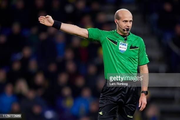 Referee Peter Kjarsgaard gestures during the Danish Superliga match between Brondby IF and AaB Aalborg at Brondby Stadion on March 10 2019 in Brondby...