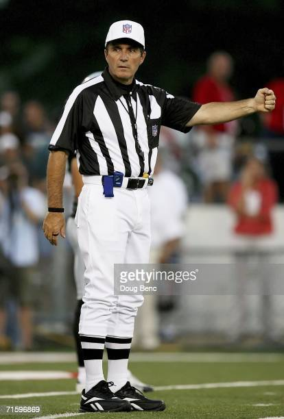 Referee Peter Morelli prepares to start a play as the Oakland Raiders take on the Philadelphia Eagles in the AFCNFC Pro Football Hall of Fame Game at...