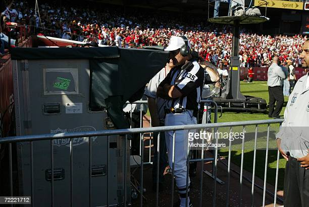 Referee Peter Morelli reviews a replay during the game between the San Francisco 49ers and the Oakland Raiders at Monster Park on October 8 2006 in...