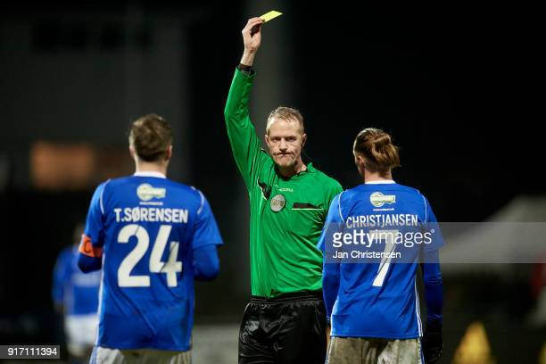 Referee Peter Munch Larsen with a yellow card for Jesper Christjansen of Lyngby BK during the Danish Alka Superliga match between Lyngby BK and...