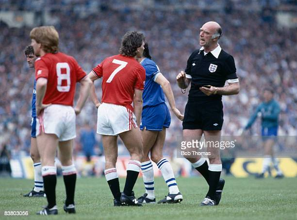 Referee Peter Willis speaks to Manchester United captain Bryan Robson during the FA Cup Final between Manchester United and Everton at Wembley...