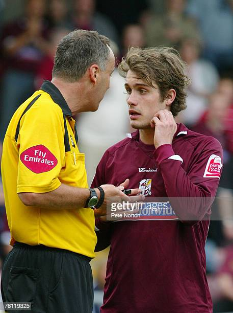 Referee Phil Crossley lectures Ryan Gilligan of Northampton during the Coca Cola League One match between Northampton Town and Scunthorpe United at...