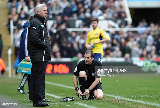Referee Phil Dowd changes his boots during the Barclays Premier League match between Newcastle United and Sunderland at St James' Park on February 01...