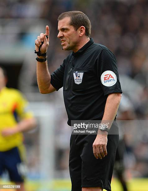 Referee Phil Dowd gestures the Barclays Premier League match between Newcastle United and Sunderland at St James' Park on February 1 2014 in...