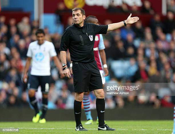 Referee Phil Dowd gives a free kick