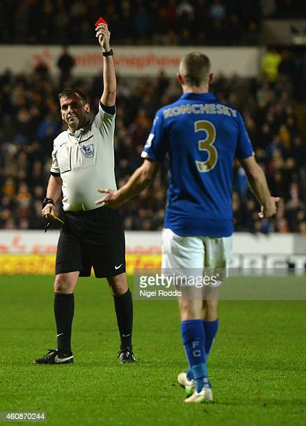 Referee Phil Dowd shows Paul Konchesky of Leicester City a red card during the Barclays Premier League match between Hull City and Leicester City at...