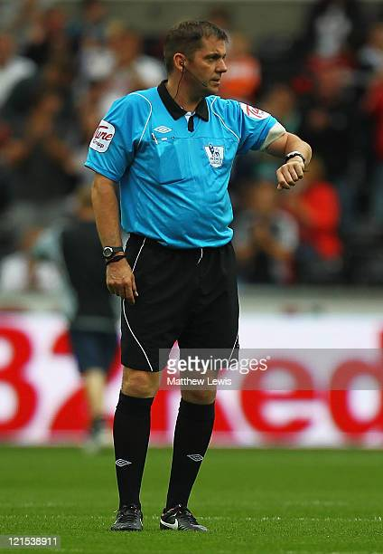 Referee Phil Dowd waits for the two teams at the start of the second half during the Barclays Premier League match between Swansea City and Wigan...