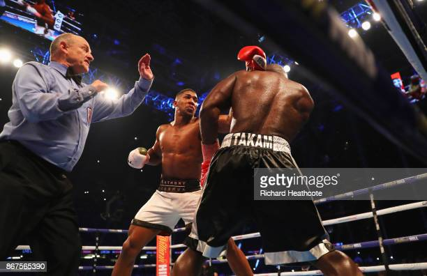 Referee Phil Edwards steps in to stop the fight in the 10th round to hand victory to Anthony Joshua during the IBF, WBA & IBO Heavyweight...