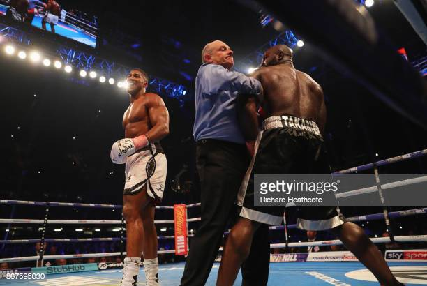Referee Phil Edwards steps in to stop the fight in the 10th round to hand victory to Anthony Joshua during the IBF WBA IBO Heavyweight Championship...
