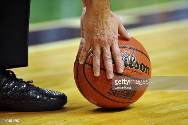 A referee picks up the game ball during a game against the Georgia Tech Yellow Jackets and the North Carolina Tar Heels during the first half of the...