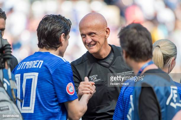 Referee Pierluigi Collina shake hands with Jari Litmanen before the UEFA Match for Solidarity at Stade de Geneva on April 21 2018 in Geneva...