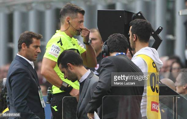 Referee Piero Giacomelli consult VAR during the Serie A match between AC Milan and Genoa CFC at Stadio Giuseppe Meazza on October 22 2017 in Milan...