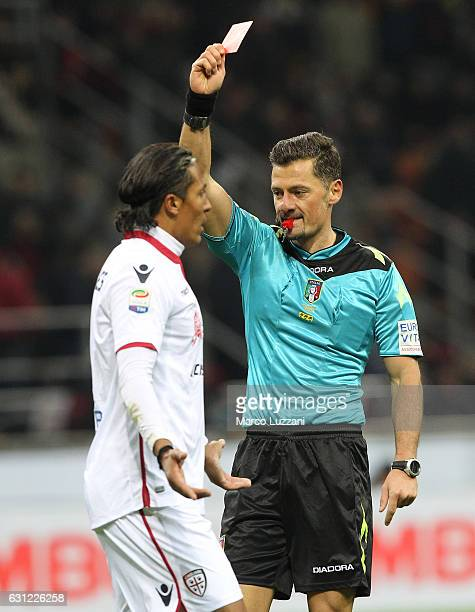Referee Piero Giacomelli shows the red card to Bruno Eduardo Alves of Cagliari Calcio during the Serie A match between AC Milan and Cagliari Calcio...