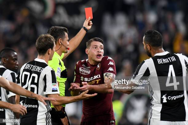 Referee Piero Giacomelli shows the red card to Daniele Baselli of Torino FC during the Serie A match between Juventus and Torino FC on September 23...