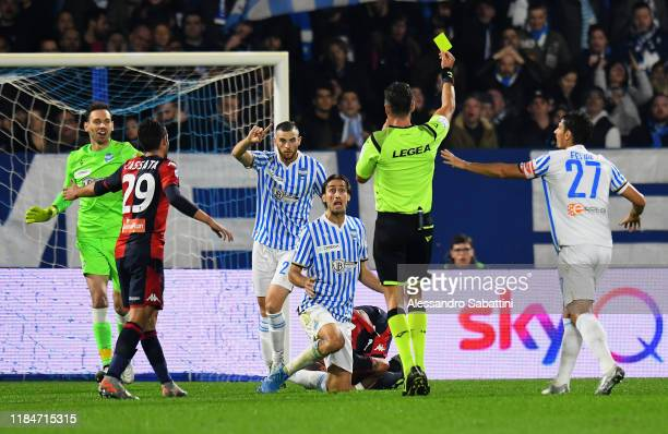Referee Piero Giacomelli shows the yellow card to Simone Missiroli of SPAL during the Serie A match between SPAL and Genoa CFC at Stadio Paolo Mazza...