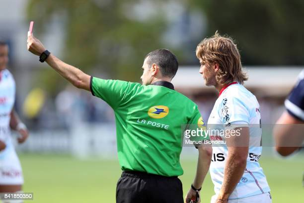 referee Pierre Brousset shows a red card to Anthony Tuitavake of Racing 92 during the Top 14 match between Agen v Racing 92 on September 2 2017 in...