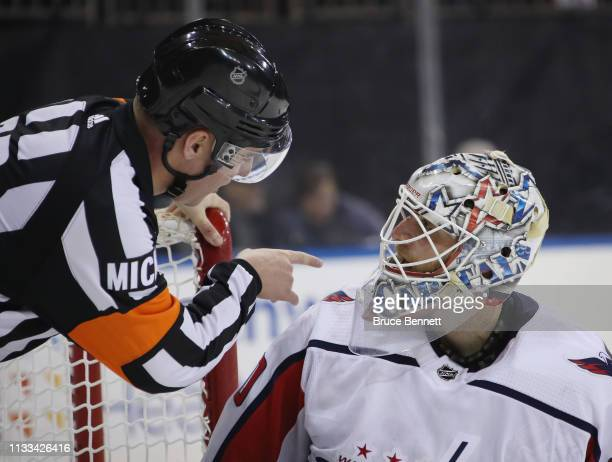 Referee Pierre Lambert makes a point with Braden Holtby of the Washington Capitals during the game against the New York Rangers at Madison Square...