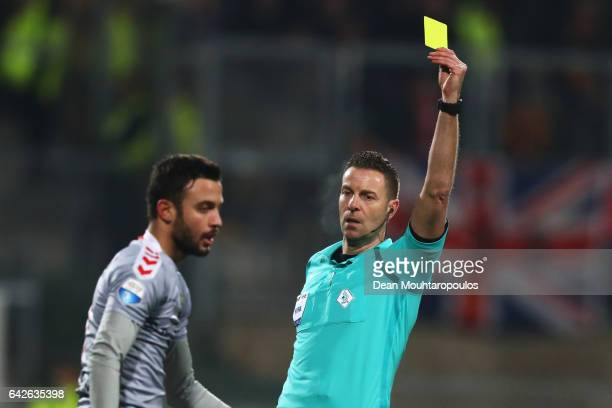 Referee Pol van Boekel shows Sebastien Locigno of Go Ahead Eagles a yellow card during the Dutch Eredivisie match between Roda JC and Go Ahead Eagles...