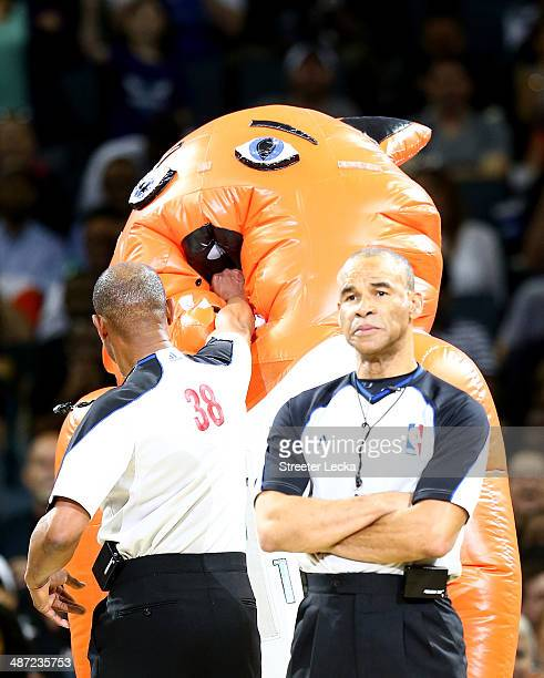 A referee punches a Charlotte Bobcats mascot in Game Four of the Eastern Conference Quarterfinals during the 2014 NBA Playoffs at Time Warner Cable...