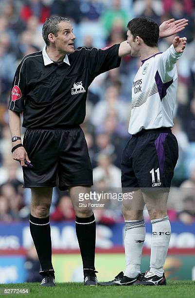 Referee R Beeby tells Jon Macken of Manchester City about his decision during the Barclays Premiership match between Aston Villa and Manchester City...