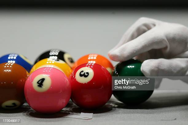 A referee racks the balls ahead of play in the Billiards Men's 9 Ball Single Quarterfinals matches at Songdo Convensia on day three of the 4th Asian...